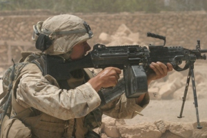 KARABILAH, Iraq- (June 17, 2005)  Marines open fire on a sniper in Karabilah after recieving fire. Offcial USMC photo.