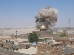 A Marine Corps Line Charge - a thousand pounds of high explosive designed to clear vehicle lanes through minefields - detonates on an IED-strewn street in Karabilah, Iraq during Operation SPEAR. June 17, 2005