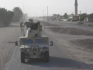 A Voodoo turret gunner scans for threats near the Mudiq mosque. August 14, 2006