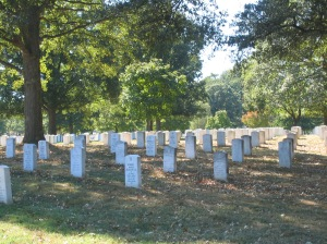 Rows of headstones shadowed by a late September sun. Arlington National Cemetery. Sept 2005