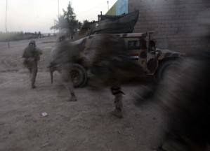 Marines sprint for cover in Sadiqiyah, Iraq. August 1, 2006