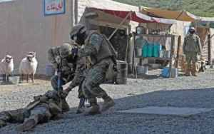 "Marines evacuate a ""casualty"" in an urban mock up."