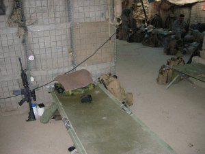 "Lt Smith's ""rack"" on a highway overpass in Iraq in October 2006 - the 611 Bridge. Marines cleaned themselves as best they could with baby wipes; weapons, however, were maintained meticulously. Insurgents targeted the bridge nearly every day"