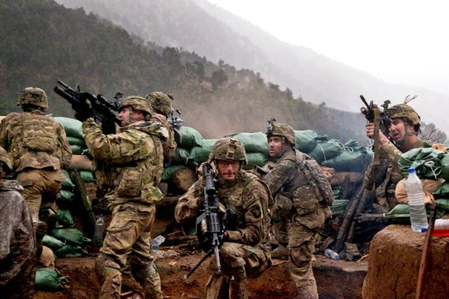 Soldiers return fire from a mountain outpost in Afghanistan. Note the Taliban had the high ground.